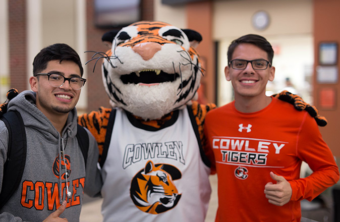 Two Cowley College students with Tank the Mascot.
